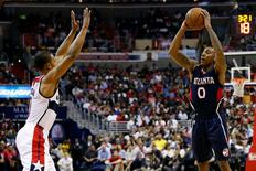 Atlanta Hawks guard Jeff Teague (0) controls the ball in front of Washington Wizards guard Ramon Sessions (7) in the second quarter in game four of the second round of the NBA Playoffs at Verizon Center. The Hawks won 106-101, and tied the series at 2-2. Mandatory Credit: Geoff Burke-USA TODAY Sports