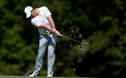 May 9, 2015; Ponte Vedra Beach, FL, USA; Rory McIlroy hits his approach to the 14th hole during the third round of The Players Championship golf tournament at TPC Sawgrass - Stadium Course. Mandatory Credit: Jake Roth-USA TODAY Sports