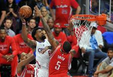 May 14, 2015; Los Angeles, CA, USA; Los Angeles Clippers center DeAndre Jordan (6) moves to the basket against the defense of Houston Rockets forward Josh Smith (5) during the second half in game six of the second round of the NBA Playoffs. at Staples Center. Mandatory Credit: Gary A. Vasquez-USA TODAY Sports