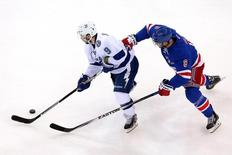 Tampa Bay Lightning center Tyler Johnson (9) controls the puck against New York Rangers defenseman Kevin Klein (8) during the first period of game two of the Eastern Conference Final of the 2015 Stanley Cup Playoffs at Madison Square Garden. May 18, 2015; New York, NY, USA; Brad Penner-USA TODAY Sports