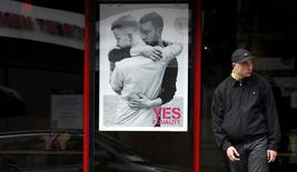 A restaurant displays a poster supporting the Yes vote, in the Caple Street area of Dublin in Ireland May 18, 2015.  REUTERS/Cathal McNaughton