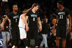 Minnesota Timberwolves point guard Zach LaVine (8) celebrates with point guard Lorenzo Brown (7) and small forward Andrew Wiggins (22) during overtime against the New York Knicks at Madison Square Garden.  Mandatory Credit: Brad Penner-USA TODAY Sports
