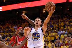 Golden State Warriors guard Stephen Curry (30) shoots a layup against Houston Rockets forward Josh Smith (5) during the fourth quarter in game one of the Western Conference Finals of the NBA Playoffs at Oracle Arena. The Warriors defeated the Rockets 110-106. Mandatory Credit: Kyle Terada-USA TODAY Sports