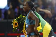 First placed Veronica Campbell-Brown of Jamaica celebrates after the women's 100m event during the Weltklasse Diamond League meeting at the Letzigrund stadium in Zurich August 28, 2014.            REUTERS/Ruben Sprich