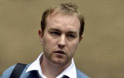 Former trader Tom Hayes leaves Southwark Crown Court in London October 21, 2013. REUTERS/Toby Melville