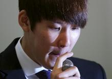 South Korea's Olympic swimming champion Park Tae-hwan reacts as he answers reporters' questions during a news conference at a hotel in Seoul March 27, 2015.   REUTERS/Kim Hong-Ji
