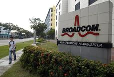 A man passes Broadcom's Asia operations headquarters office at an industrial park in Singapore September 16, 2014.   REUTERS/Edgar Su