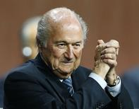 FIFA President Sepp Blatter gestures after he was re-elected at the 65th FIFA Congress in Zurich, Switzerland, May 29, 2015. REUTERS/Arnd Wiegmann