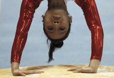 Phan Thi Ha Thanh of Vietnam competes on the vault during the women's apparatus final at the Artistic Gymnastics World Championships in Tokyo October 15, 2011. REUTERS/Toru Hanai/Files
