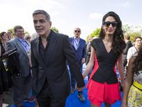"Cast member George Clooney arrives with his wife Amal at the premiere of ""Tomorrowland"" at AMC theatres in Downtown Disney in Anaheim, California May 9, 2015. The movie opens in the U.S. on May 22.  REUTERS/Mario Anzuoni"