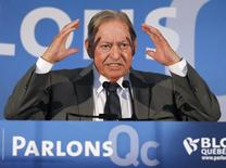 Former Quebec premier Jacques Parizeau talks to supporters as the campaigns with Bloc Quebecois leader Gilles Duceppe in the Montreal suburb of Longueuil, April 25, 2011.   REUTERS/Shaun Best