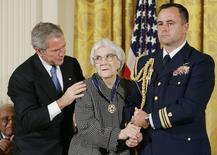 Former U.S. President George W. Bush (L) awarding the Presidential Medal of Freedom to novelist Harper Lee (C) in the East Room of the White House, November 5, 2007.  REUTERS/Larry Downing