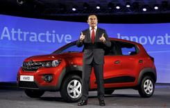 Carlos Ghosn, CEO of the Renault-Nissan Alliance, speaks to the media as he stands next to Renault's new Kwid car during its launch in Chennai, India, May 20, 2015. REUTERS/Stringer
