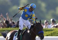 Jockey Victor Espinoza, aboard American Pharoah, celebrates after wining the 147th running of the Belmont Stakes as well as the Triple Crown, in Elmont, New York June 6, 2015.   REUTERS/Shannon Stapleton
