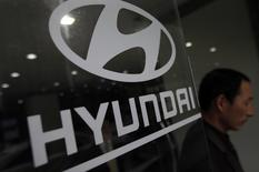 A visitor walks past a Hyundai Motor logo at a Hyundai dealership in Seoul in this file photo taken on April 25, 2013. REUTERS/Kim Hong-Ji