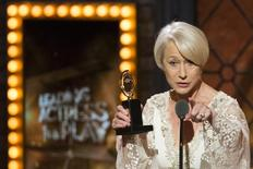"British actress Helen Mirren accepts the award for Best Performance By An Actress In A Leading Role In A Play for ""The Audience"". REUTERS/Lucas Jackson"