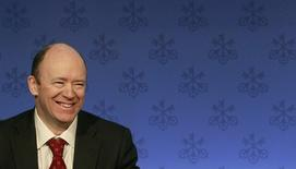 John Cryan smiles as he addresses a news conference in this February 8, 2011 file picture. REUTERS/Arnd Wiegmann