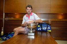 Tennis - French Open - Roland Garros, Paris, France - 7/6/15 Switzerland's Stanislas Wawrinka in the locker room with the trophy after winning the men's final Action Images via Reuters/Christophe Saidi/FFT/Pool Livepic