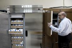 Paul Arnaoutis, founder and managing director of medical products supplier Paul Arnaoutis S.A, opens medical fridges full of supplies at his company's headquarters in Athens June 9, 2015.   REUTERS/Alkis Konstantinidis