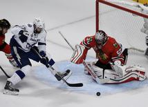 Jun 10, 2015; Chicago, IL, USA; Chicago Blackhawks goalie Corey Crawford (50) defends the goal as Tampa Bay Lightning center Alex Killorn (17) attempts a shot during the third period of game four of the 2015 Stanley Cup Final at United Center. Mandatory Credit: David Banks-USA TODAY Sports