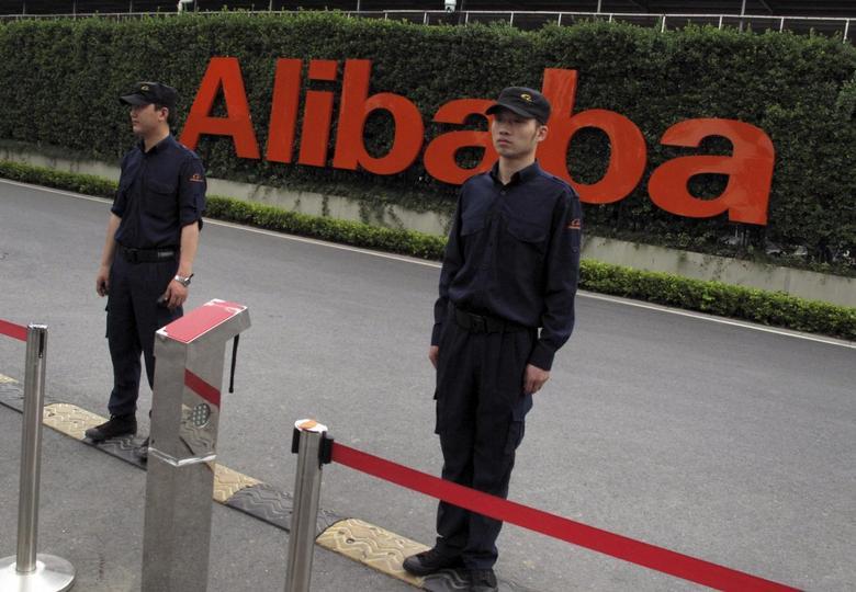 Guards stand near an entrance to Alibaba's headquarters in Hangzhou, Zhejiang province, China, May 18, 2015.  REUTERS/John Ruwitch