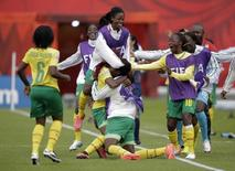Jun 16, 2015; Edmonton, Alberta, CAN; Cameroon forward Madeleine Ngono Mani (9) celebrates with teammates after scoring a goal during the second half against Switzerland in a Group C soccer match in the 2015 FIFA women's World Cup at Commonwealth Stadium. Mandatory Credit: Erich Schlegel-USA TODAY Sports