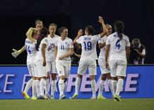 Jun 17, 2015; Montreal, Quebec, CAN; England players celebrate the victory against Colombia in a Group F soccer match in the 2015 FIFA women's World Cup at Olympic Stadium. Mandatory Credit: Jean-Yves Ahern-USA TODAY Sports