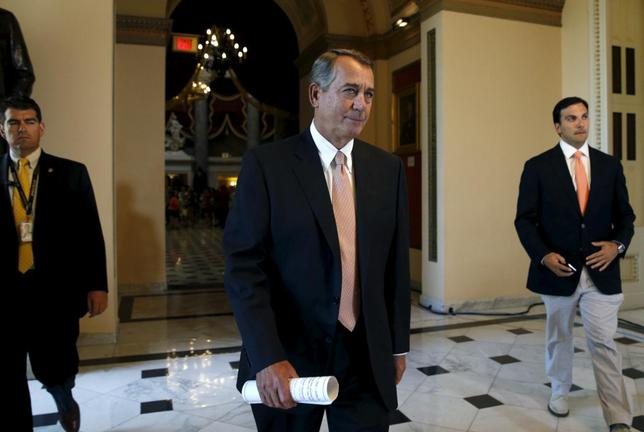 Speaker of the House John Boehner walks to the House Chamber where members of congress were voting on a package of trade bills in the U.S. Capitol in Washington June 12,  2015. REUTERS/Kevin Lamarque
