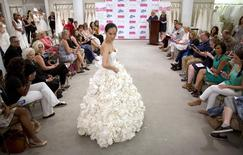 A model walks the runway wearing 'Garden Party' a design by Carol Touchstone during the 11th annual toilet paper wedding dress contest at Kleinfled's Bridal Boutique in New York June 17, 2015. REUTERS/Brendan McDermid