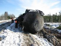Investigators work at the scene of a January 7 derailment a involving Canadian National Railway (CN) mixed freight train near Plaster Rock, New Brunswick in this image obtained from The Transportation Safety Board of Canada on January 10, 2014. REUTERS/The Transportation Safety Board of Canada/Handout via Reuters