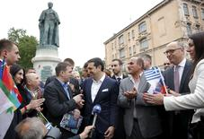 Greek Prime Minister Alexis Tsipras (C) speaks with Greek expatriates in frot of the statue of Russian-born founder of modern Greek state Ioannis Kapodistrias in St. Petersburg, Russia, June 19, 2015. REUTERS/Maxim Shemetov
