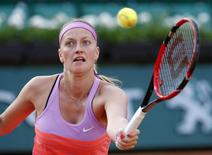 Petra Kvitova of the Czech Republic returns the ball to Timea Bacsinszky of Switzerland during their women's singles match during the French Open tennis tournament at the Roland Garros stadium in Paris, France, June 1, 2015.                 REUTERS/Jean-Paul Pelissier