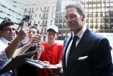 New England Patriot's quarterback Tom Brady arrives at NFL headquarters as people ask for autographs in New York June 23, 2015.  REUTERS/Shannon Stapleton