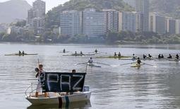 Members of the State Federation of Rowing and others take part in a protest against violence at Rodrigo de Freitas lagoon, where a cyclist was killed the week before during a bicycle robbery, in Rio de Janeiro, Brazil, in this file picture taken May 24, 2015. REUTERS/Sergio Moraes/Files