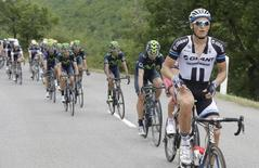 Giant-Shimano team rider Marcel Kittel (R) of Germany leads the pack of riders during the 222-km 15th stage of the Tour de France cycling race between Tallard and Nimes, July 20, 2014.     REUTERS/Jacky Naegelen