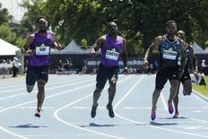 Tyson Gay (L) of the U.S. wins the 100m at the IAAF Diamond League Grand Prix track and field competition in New York June 13, 2015. REUTERS/Eduardo Munoz -