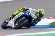 Yamaha MotoGP rider Valentino Rossi of Italy takes a curve during a qualifying session at the TT Assen Grand Prix at Assen, Netherlands June 26, 2015. REUTERS/Ronald Fleurbaaij