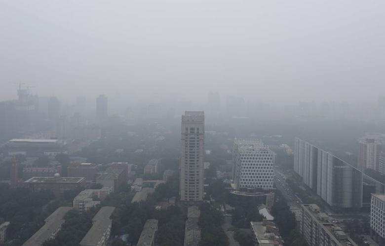 Buildings are pictured on a hazy day in Beijing, June 25, 2015. REUTERS/Jason Lee
