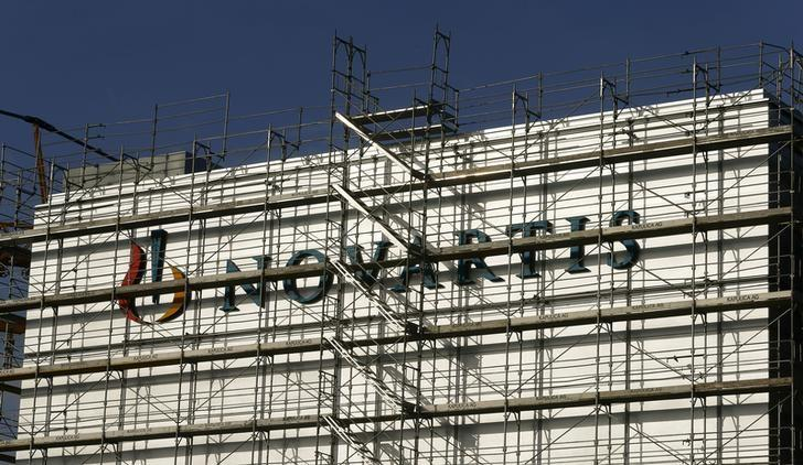 Swiss drugmaker Novartis' logo is seen behind scaffolding at the company's plant in the northern Swiss town of Stein February 4, 2015.  REUTERS/Arnd Wiegmann