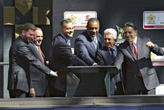 Scotiabank Mexico CEO Enrique Zorrilla (2nd L), Scotiabank Chief Marketing Officer John Doig (3rd L), President of CONCACAF Jeffrey Webb (3rd R), Mexican Football Federation (FEMEXFUT) President Justino Compean (2nd R), and Aaron Davidson (R), president of the sponsorship rights agency Traffic Sports USA, gesture during a joint presentation between Scotiabank and the CONCACAF at the Stock Exchange in Mexico City in a December 9, 2014 file photo. REUTERS/File