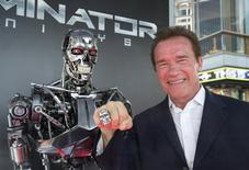 "Cast member Arnold Schwarzenegger poses by a Terminator replica at the premiere of ""Terminator Genisys"" in Hollywood, California June 28, 2015. The movie opens in the U.S. on July 1.  REUTERS/Mario Anzuoni"