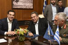Greek Prime Minister Alexis Tsipras (L), Defence Minister Panos Kammenos (C) and General Mikhail Kostarakos, chief of Hellenic National Defence General Staff, meet at the Defence ministry premises in this handout photo released by the Greek Defence Ministry in Athens, Greece July 2, 2015.  REUTERS/Greek Defence Ministry/Handout via Reuters