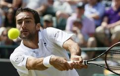 Marin Cilic of Croatia celebrates hits a shot during his match against John Isner of the U.S.A. at the Wimbledon Tennis Championships in London, July 4, 2015.                  REUTERS/Stefan Wermuth