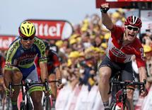 Lotto-Soudal rider Andre Greipel of Germany (R) celebrates as he wins ahead of Tinkoff-Saxo rider Peter Sagan of Slovakia (L) at the 166-km (103.15 miles) second stage of the 102nd Tour de France cycling race from Utrecht to Zeeland, July 5, 2015. REUTERS/Benoit Tessier