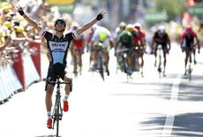 Etixx-Quick Step rider Zdenek Stybar of Czech Republic celebrates as he crosses the finish line to win the 191.5-km (118.9 miles) 6th stage of the 102nd Tour de France cycling race from Abbeville to Le Havre, France, July 9, 2015. REUTERS/stefano Rellandini