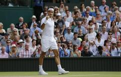 Roger Federer of Switzerland celebrates after winning his match against Andy Murray of Britain at the Wimbledon Tennis Championships in London, July 10, 2015.                                         REUTERS/Suzanne Plunkett