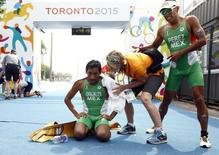Jul 12, 2015; Toronto, Ontario, CAN; Crisanto Grajales  of Mexico and Irving Perez of Mexcio reacts at the finish line the men's triathlon during the 2015 Pan Am Games at Ontario Place West Channel. Mandatory Credit: Rob Schumacher-USA TODAY Sports