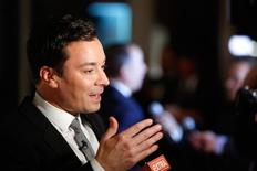 Television show host Jimmy Fallon talks to reporters on the red carpet for the taping of the Mark Twain Prize for Humor ceremony and performance at the Kennedy Center in Washington October 19, 2014.  REUTERS/Jonathan Ernst