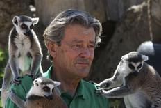 Jean-Jacques Lesueur sits surrounded with Madagascar lemurs in Athens, Greece July 16, 2015. REUTERS/Yiannis Kourtoglou