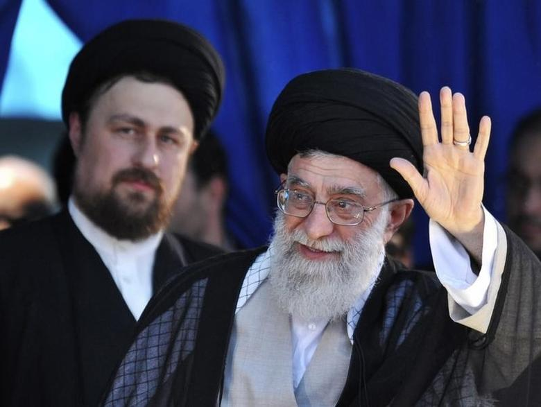 Iran's Supreme Leader Ayatollah Ali Khamenei (R) waves to his supporters as Hassan Khomeini, grandson of Iran's Late Leader Ayatollah Ruhollah Khomeini, looks on during a ceremony to mark the death anniversary of the Islamic Republic founder Ayatollah Khomeini at Khomeini's shrine in southern Tehran June 4, 2010. REUTERS/IIPA/Sajjad Safari/Files